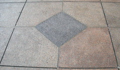 Bow Tie Block in the Sidewalk at Lincoln Plaza