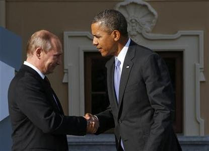 Russia's President Vladimir Putin (L) welcomes U.S. President Barack Obama before the first working session of the G20 Summit in Constantine Palace in Strelna near St. Petersburg, September 5, 2013. REUTERS-Grigory Dukor