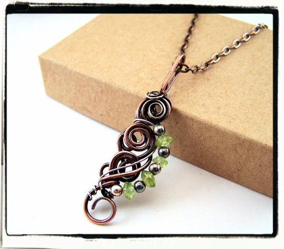 My newest design!  This one is made from copper, sterling silver, and green peridot.