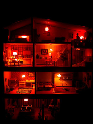 Vintage mid-seventies Lundby dolls' house, lit up at night.