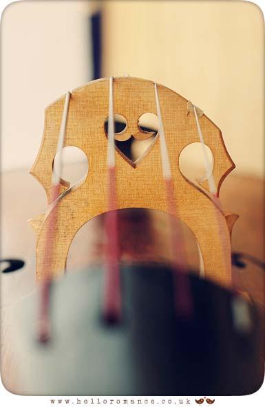 Heart in French cello bridge at wedding - Hello Romance