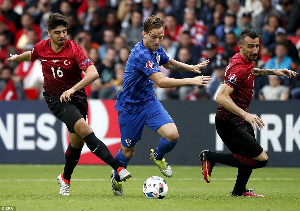 Ivan Rakitic (centre) of Croatia and Barcelona had a strong game in midfield alongside Madrid man and goalscorer Modric