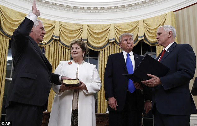 Democrats also said they feared Tillerson's four-decade career at the energy giant meant he'd view the world only through the lens of a corporate executive (he is pictured being sworn in)