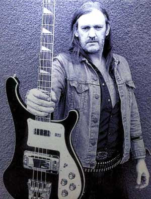 Lemmy holding a guitar on the back of the CD