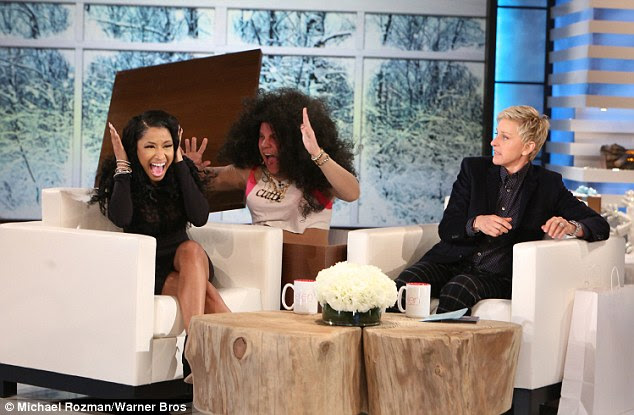 Surprise: The Anaconda singer got a shock when Ellen had a man wearing a giant wig leap out of a hidden box to scare Nicki