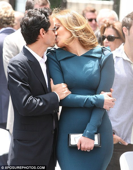 Before the split: Jennifer Lopez and husband Marc put on a public display of affection as Simon Fuller receives his star on the Hollywood Walk of Fame in May