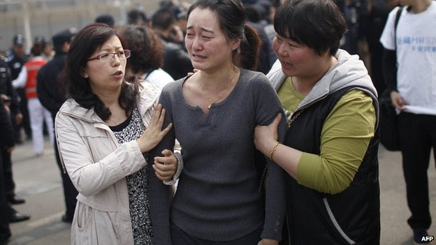 Grieving relative outside Malaysian embassy in Beijing. 24 March 2014