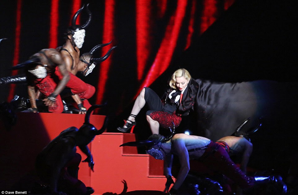 Turn for the worse: Madonna was pulled off the stage as she performed at the BRIT Awards in London on Wednesday night