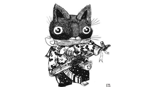 Gato armado como se fosse um rebelde do ISIS