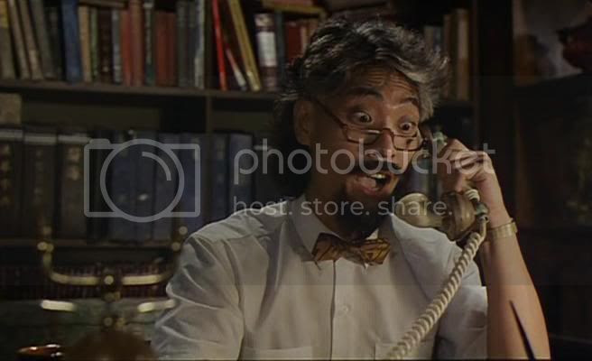 Chung Fat as Professor Kwok