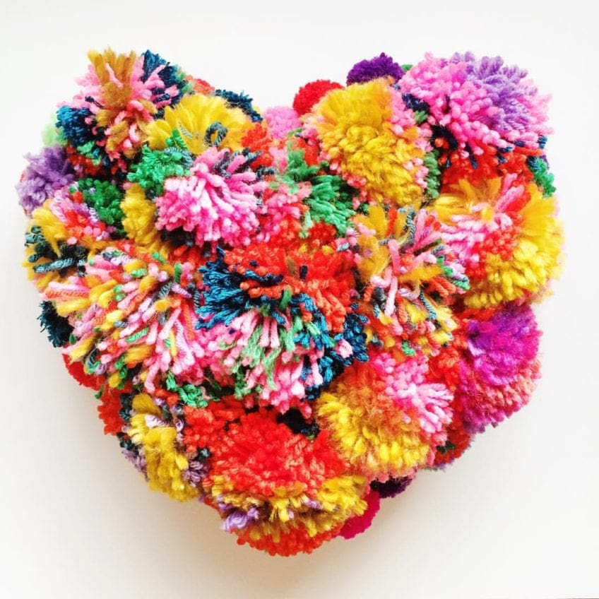 Easy colorful DIY pompom pillows.