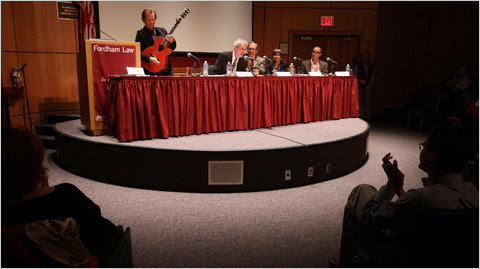 Pete Kennedy, left, and fellow panelists expounding on Bob Dylan the jurisprudential theorist at Fordham on Monday.