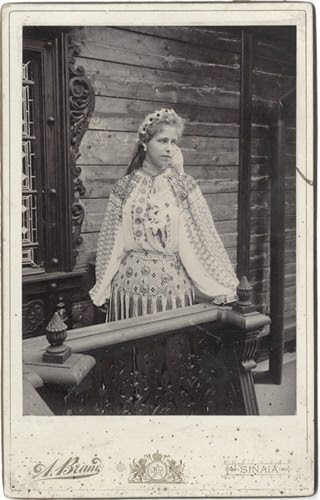 Queen Marie of Romania in peasant costume on the veranda of a traditional house, end 19th c. (Diana Mandache collection)