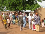 Brighter future? Villagers in Kpasenkpe, which was recently visited by rock star Bono
