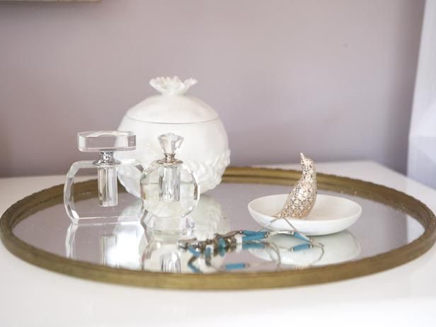 Simple, elegant accessories on a mirrored tray add to the feminine style of a lavender bedroom. | By designer Emily Henderson @HGTV hgtv.com