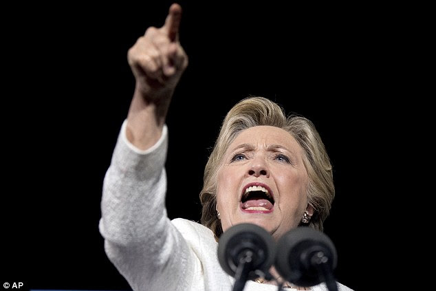 Lauderdale on Tuesday. Clinton raised her voice and pointed a finger at the protester as she exclaimed: 'I am sick and tired of the negative, dark, divisive, dangerous vision and the anger of people who support Donald Trump'