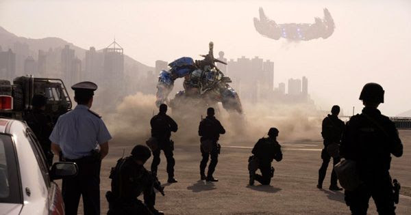 In Hong Kong, Optimus Prime is confronted by Chinese security forces at the end of TRANSFORMERS: AGE OF EXTINCTION.