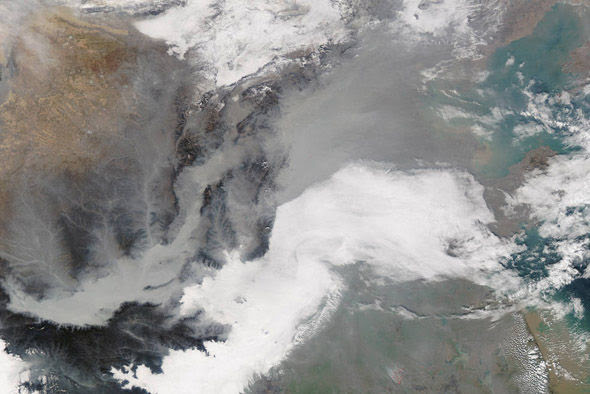 On December 7, NASA's Aqua satellite captured this image of eastern China being inundated by thick smog