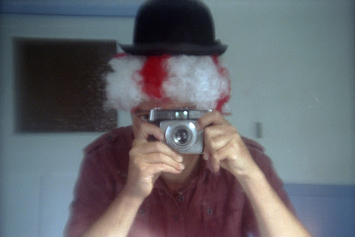 reflected self-portrait with Ilford Sportsman Auto RF camera and typically English headgear by pho-Tony