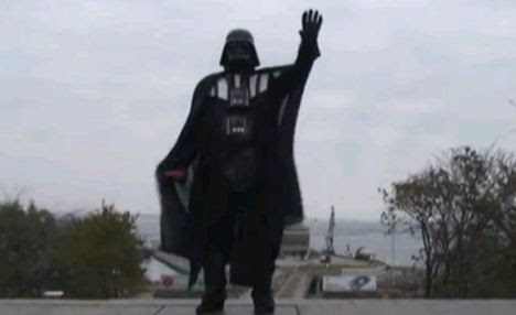 Dark arts: The masked intruder salutes his YouTube followers