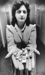 Thumbnail of Sandy Ford with vials of pentamidine for distribution to patients with Pneumocystis pneumonia.