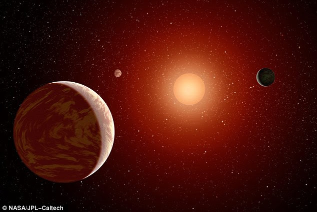A study by astrophysicists at the University of Toronto suggests that exoplanets - planets outside our solar system - are more likely to have liquid water and be more habitable than we thought. Pictured is an artist's impression of an exoplanet around a red dwarf