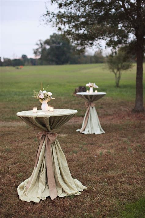 Sage pintuck linens with burlap sashes on the cocktail