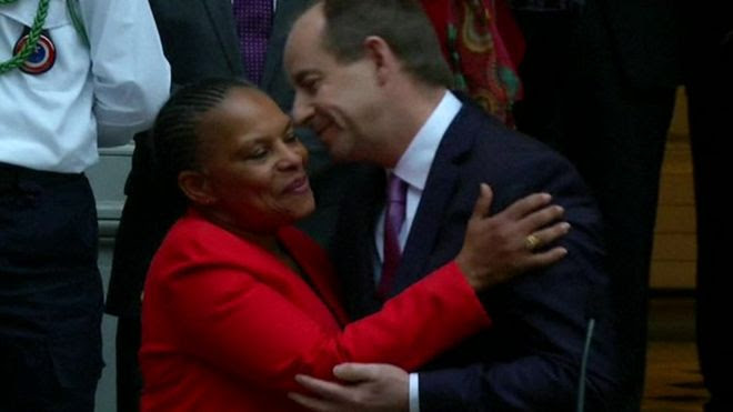 Ms Taubira embracing her successor