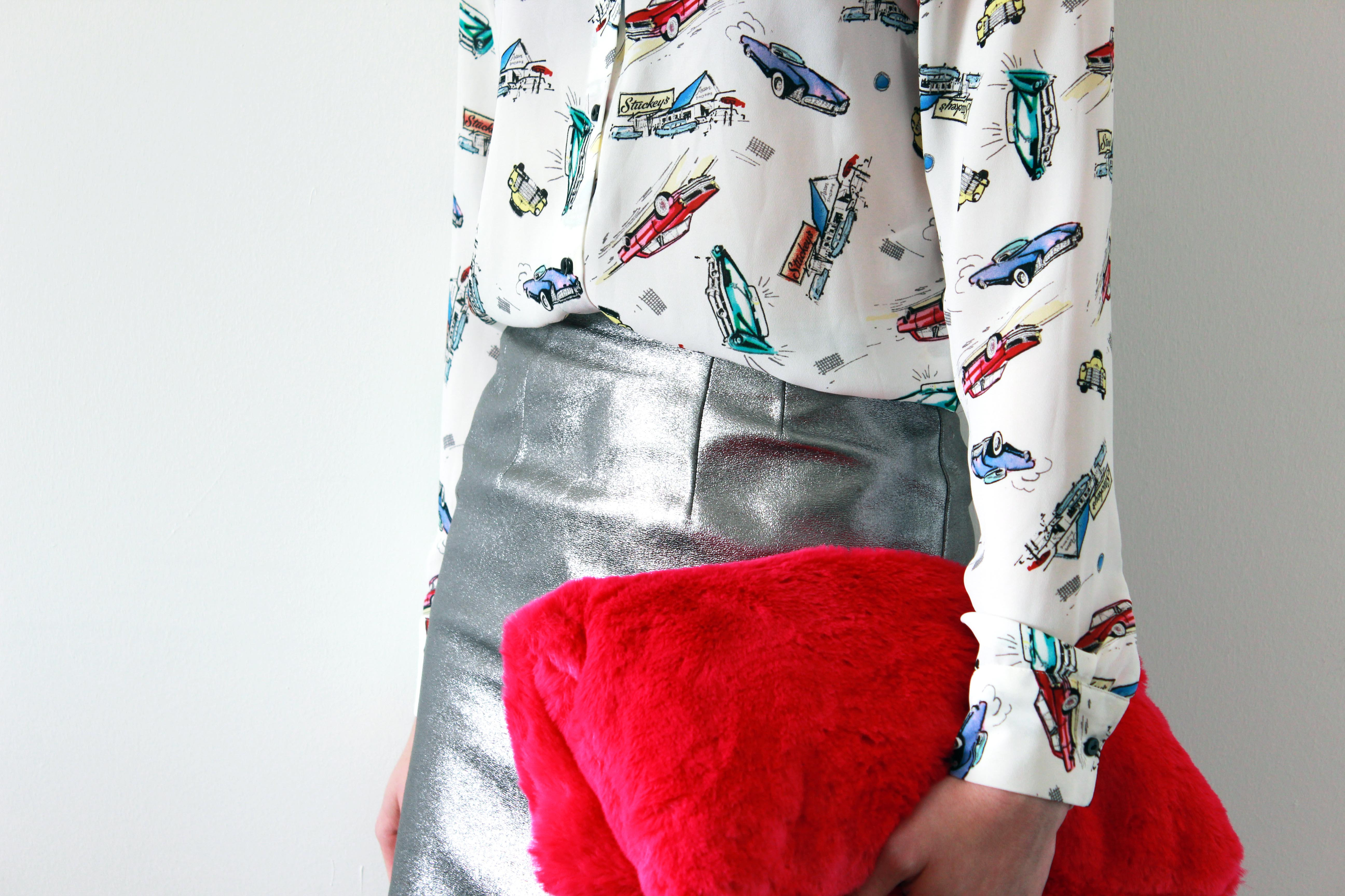 Metallic skirt, printed shirt and fur clutch outfit