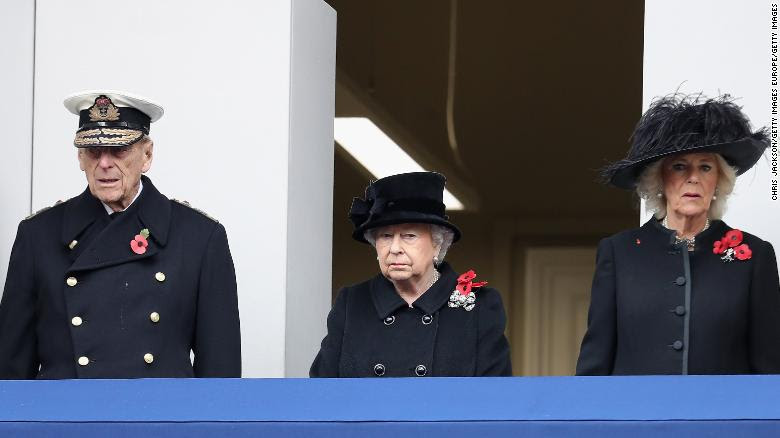 Prince Philip, Queen Elizabeth and Camilla, Duchess of Cornwall, observe the annual Remembrance Sunday memorial.
