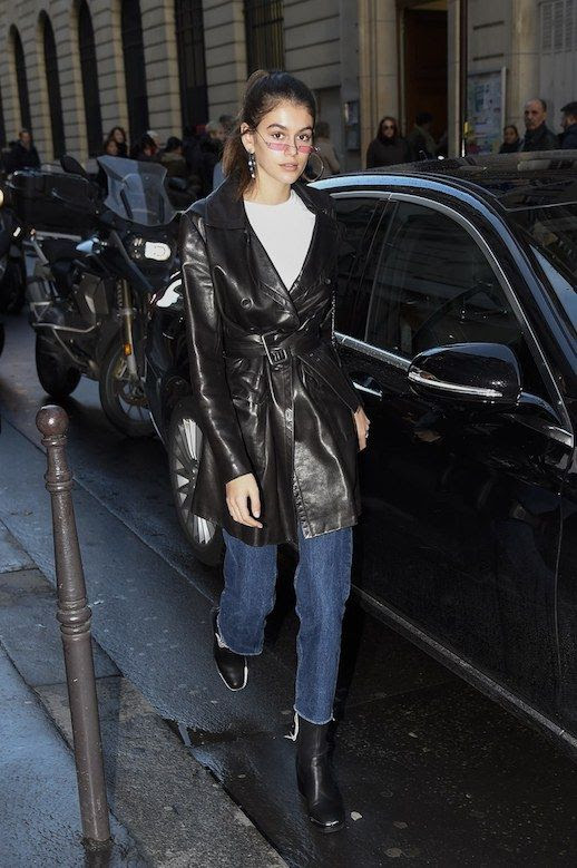 Le Fashion Blog Kaia Gerber 90s Trend Micro Sunglasses White T Shirt Leather Trench Coat Straight Leg Jeans Black Heeled Boots Via Vogue