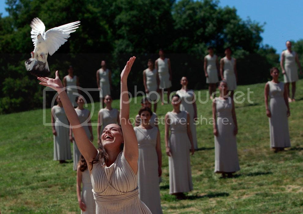 An actress, playing the role of a priestess, releases a dove during the dress rehearsal for the torch lighting ceremony of the London 2012 Olympic Games in Greece, on May 9, 2012.(Reuters/John Kolesidis)