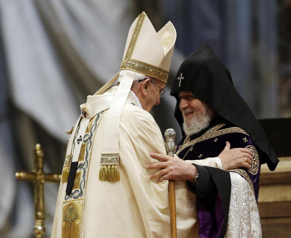 Pope Francis, left, is greeted by the head of Armenia's Orthodox Church Karekin II, during an Armenian-Rite Mass on the occasion of the commemoration of the 100th anniversary of the Armenian Genocide, in St. Peter's Basilica, at the Vatican, Sunday, April 12, 2015. Historians estimate that up to 1.5 million Armenians were killed by Ottoman Turks around the time of World War I, an event widely viewed by genocide scholars as the first genocide of the 20th century. Turkey however denies that the deaths constituted genocide, saying the toll has been inflated, and that those killed were victims of civil war and unrest. (AP Photo/Gregorio Borgia)