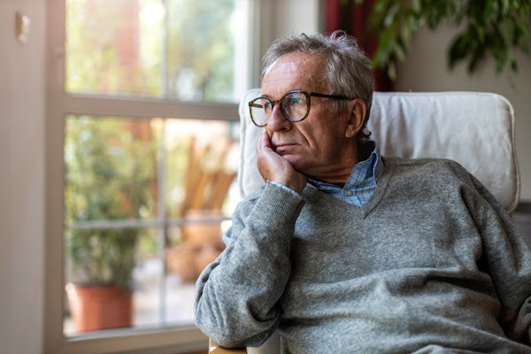 Man looking out widow