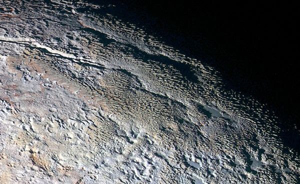 A high-resolution, enhanced-color image of Pluto's Tartarus Dorsa region that was taken by NASA's New Horizons spacecraft on July 14, 2015.