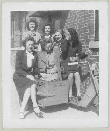 Six girls on a motorscooter
