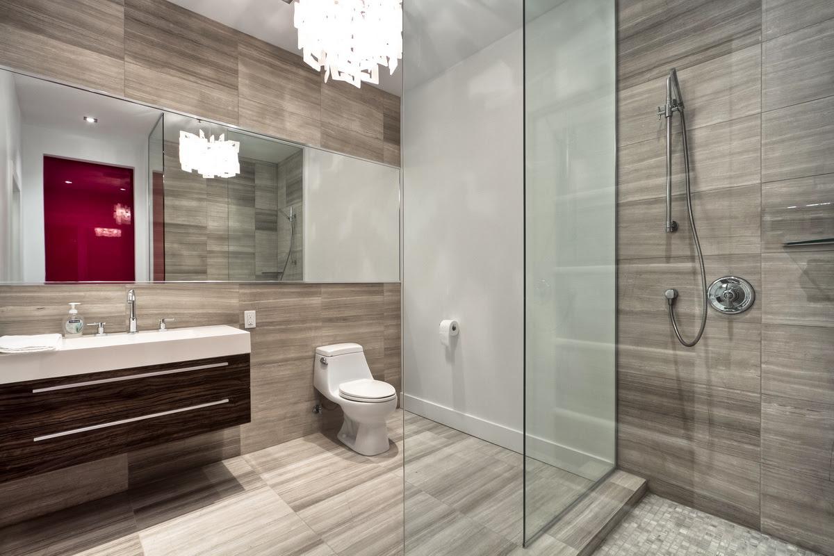 modern shower and bathroom with glass wall transparent
