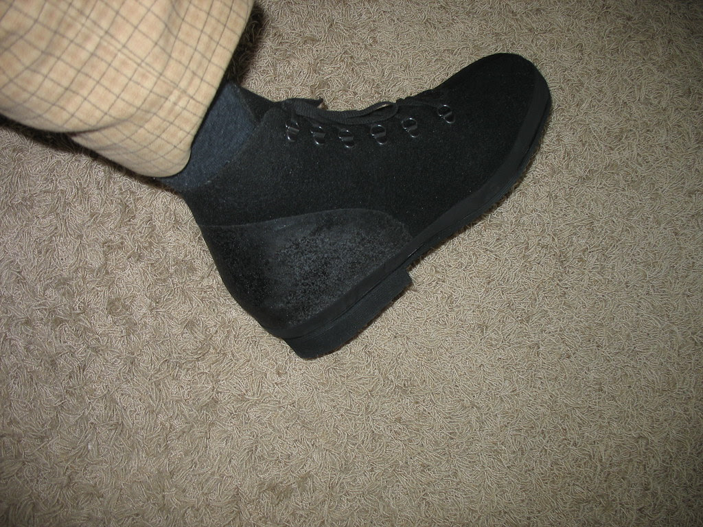 Orthopaedic shoe on left foot