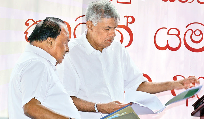 Prime Minister Ranil Wickremesinghe and Wayamba Development and Cultural Affairs Minister S.B.Navinna inspecting the work plans on the Bingiriya Export Processing Zone. Picture by Malan Karunaratne