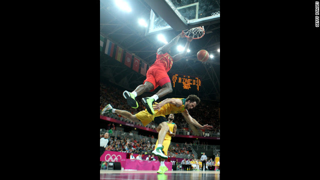 Serge Ibaka of Spain dunks over Matt Nielsen of Australia during a men's basketball preliminary round match Tuesday.