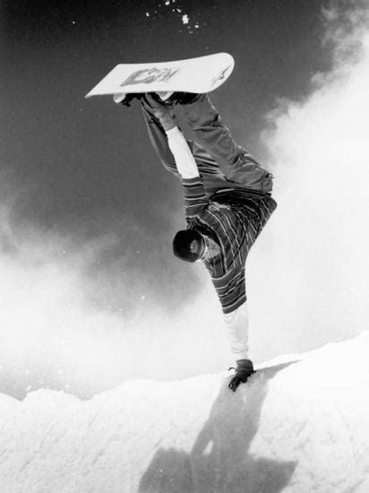 Snowboarder Doing a Handstand Photographic Print by Kurt