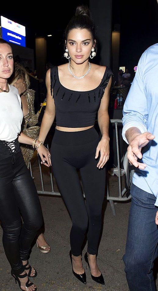 Le Fashion Blog How To Wear Leggings In Public Kendall Jenner Black Cropped Top Black Leggings Black Patent Leather Pumps Statement Earrings Via Who What Wear