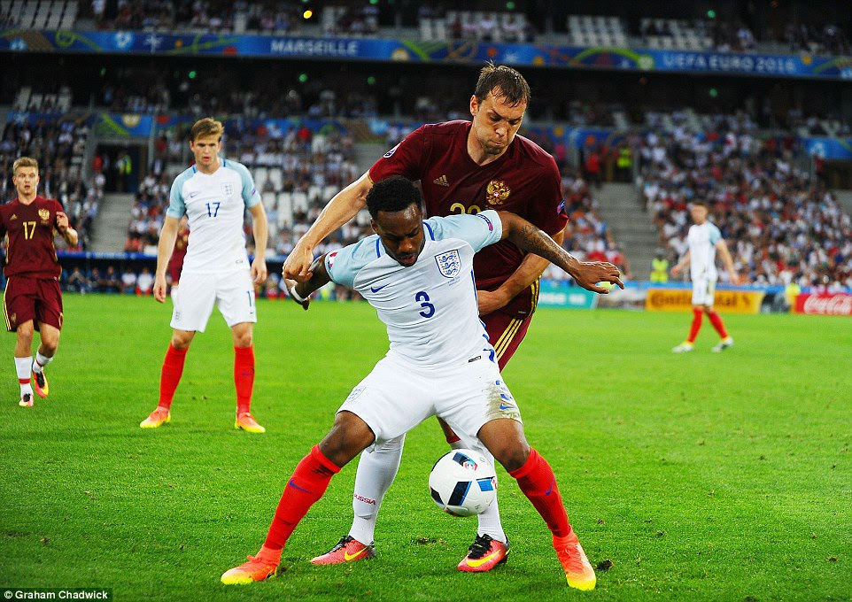 England defender Rose stays strong to hold off the challenge of Russia's Artem Dzjuba, with the score level at 0-0 in Marseille