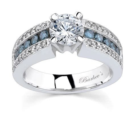 Barkev's White gold engagement ring with white & blue