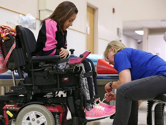 Tully: Indianapolis teen defies paralysis to cheer again