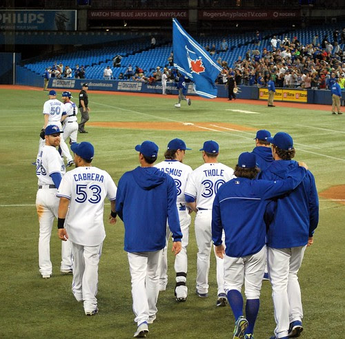 The team heads onto the field after their seventh straight win.