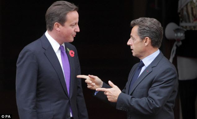 Straight shooter: David Cameron and French President Nicolas Sarkozy, pictured at Lancaster House in London today, have signed a military treaty which includes the testing of nuclear warheads