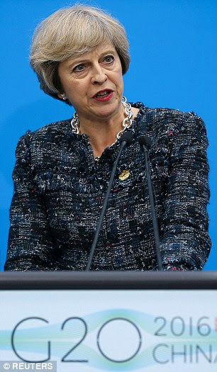 Tough stance: Prime Minister Theresa May, pictured at the closing of the G20 summit in Hangzhou, China, on Monday