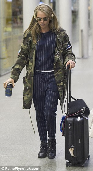 Keeping hydrated: Delevingne sipped her hot beverage as she journeyed through the station