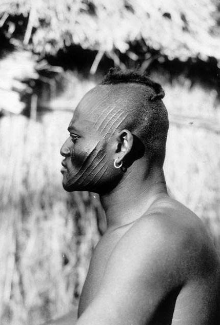 His profile reminds me of Telly's brother. Africa | A hunter from the Sara tribe.  Central Africa. ca. 1924/5 | ©RMN / Jean-Gilles Berizzi {Haardt Fund; Citroen Mission}